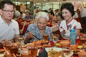 Madam Goh Oh Keing (centre), 94, enjoying a reunion lunch treat on Monday. With her are Tanjong Pagar GRC MP Joan Pereira and Mr Raymond Goh, managing director of Tong Bee Construction and one of the sponsors of the event.