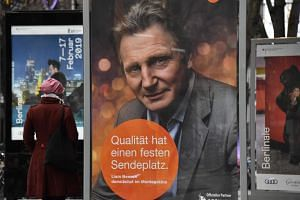 A billboard displaying a picture of Irish actor Liam Neeson at the Berlin film festival.