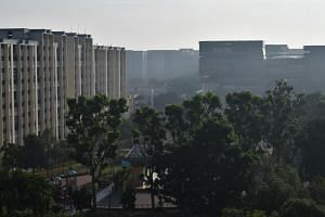 The air around the Tampines area was hazy and there was a strong burning smell when ST reached the area at about 8.30am.