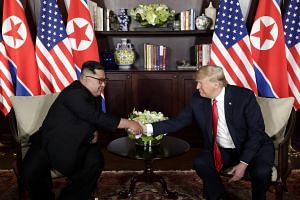 US President Donald Trump and North Korean leader Kim Jong Un at their first summit in Singapore on June 12, 2018.