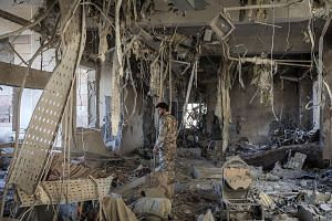 A destroyed hospital in Hajin, Syria, which was liberated from the Islamic State in Iraq and Syria last month. More than 37,000 people, mostly wives and children of hardline fighters, have fled ISIS territory since the Syrian Democratic Forces, backe
