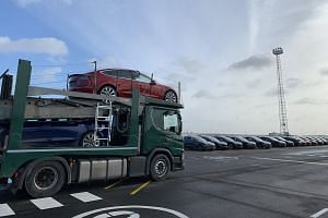 """Musk tweeted a photo (above) and said it was """"exciting to see thousands of Model 3's"""" on their way to European owners."""