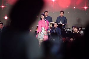 Singaporean singer Joanna Dong treated the audience to a medley of jazzed up Chinese New Year songs accompanied by Ding Yi Music Company at River Hongbao on Feb 9, 2019.