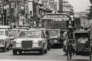 Traffic in North Bridge Road in 1968, when trishaws shared the road with cars and buses. Singapore's middle way helped show the world an alternative to communism and fascism in past decades, says the writer. The Republic can continue to show the worl