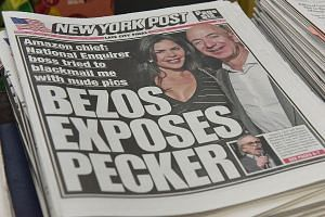 Mr Jeff Bezos and Ms Lauren Sanchez on the front page of the New York Post. Mr Bezos is accusing the National Enquirer's parent company, American Media Inc, which is run by Mr David Pecker, of
