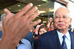 Former Malaysian Prime Minister Datuk Seri Najib Tun Razak leaves the courthouse after being charged in court in Kuala Lumpur on Dec 12, 2018.