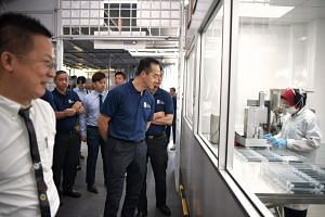 Senior Minister of State for Trade and Industry Koh Poh Koon touring the facility of medical technology manufacturing firm Racer on Feb 11, 2019.