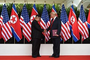 """North Korean leader Kim Jong Un with United States President Donald Trump in Singapore last June. The US is expected to seek """"concrete deliverables"""" from the upcoming Vietnam summit."""