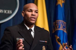 US Surgeon General, Dr Jerome Adams, gives a statement on the use of e-cigarettes by teenagers in Washington,DC on Dec 18, 2018.