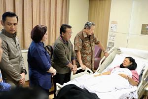 Former Indonesian First Lady Ani Yudhoyono, who has been hospitalised in Singapore since Feb 2, with her husband (second from right), former president Susilo Bambang Yudhoyono,  former coordinating minister of political, legal and security affairs D