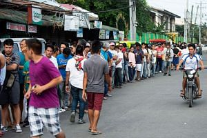 People line up to cast their ballot at a voting precinct in Cotabato on the southern Philippine island of Mindanao on Jan 21, 2019, during a vote on giving the nation's Muslim minority greater control over the region.