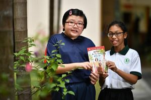 Hoon Shu Yen (left) from Minds Fernvale Gardens School and Nur Marsha Danisha Sufian from Fernvale Primary School at the launch of the first book Not So Scary After All.
