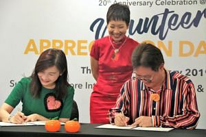 (From left) Standard Chartered Bank's regional head of corporate affairs and brand and marketing Eva Ang, Minister for Culture, Community and Youth Grace Fu, and chairman of RSVP Singapore Koh Juay Meng.