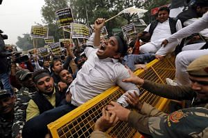 An activist of the youth wing of India's main opposition Congress party shouts slogans during a protest against the Feb 14 attack on a bus that killed 44 Central Reserve Police Force personnel, in New Delhi on Feb 15, 2019.