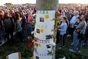 Posters with the names of victims are shown during a memorial service on the one-year anniversary of the shooting which claimed 17 lives at Marjory Stoneman Douglas High School in Parkland, Florida, on Feb 14, 2019.