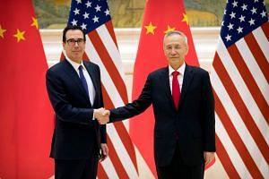 United States Treasury Secretary Steven Mnuchin and Chinese Vice-Premier and lead trade negotiator Liu He greeting each other before the start of trade negotiations in Beijing yesterday.