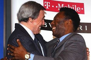 Brazilian legend Pele and former England goalkeeper Gordon Banks embracing at a 2004 news conference in London for the announcement of Fifa's 125 greatest living footballers. Not surprisingly, both were in the list.