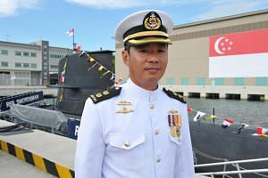 """Senior Lieutenant-Colonel Loh Mun Heng is fond of whiskey but was determined not to receive a bottle of it during the """"Perisher"""" submarine command course in 2007 because it is given to trainees who fail the course."""