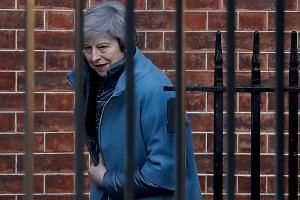 Britain's Prime Minister Theresa May leaves from the rear of 10 Downing Street in London on Feb 14, 2019 ahead of a vote on amendments to the Brexit withdrawal bill.