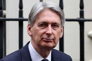 Hammond reportedly axed the trip amid anger in Beijing over plans to send a new aircraft carrier to the Pacific.