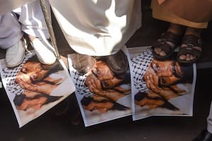Indian Muslims stamping on photos of Jaish-e-mohammad group chief Maulana Masood Azhar, believed to be the uncle of attack mastermind Mohammed Umair.