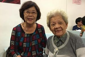 Retiree Margaret Yeo 71, with her mother, Ng Guan Cheng, 92, who has dementia.