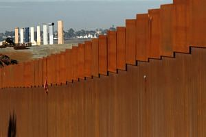 The prototypes for US President Donald Trump's border wall are seen behind the border fence between Mexico and the United States, in Tijuana, Mexico, on Jan 7, 2019.