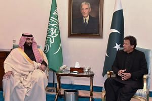 Pakistan's Prime Minister Imran Khan (right) speaks with Saudi Arabian Crown Prince Mohammed bin Salman at the Prime Minister House upon his arrival in Islamabad on Feb 17, 2019.
