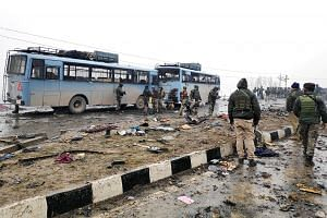 Indian soldiers examining the debris last Thursday after an attack in south Kashmir's Pulwama district. Jaish-e-Mohammed, an extremist group that pioneered suicide bombings in Kashmir, claimed responsibility for the attack.