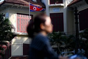 A woman rides past the North Korean embassy in Hanoi on Feb 6, 2019. The US envoy is expected to fly soon to Hanoi from Washington to resume talks with Kim Hyok Chol.