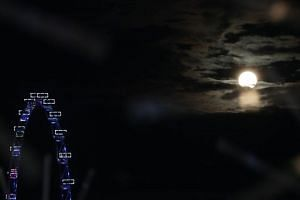The Supermoon seen here with the Singapore Flyer on Feb 19, 2019.