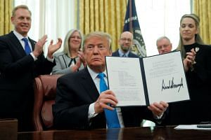 Trump displays the directive he signed to establish a Space Force as the sixth branch of the Armed Forces.