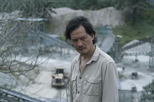 Peter Yu plays Detective Lok in A Land Imagined.