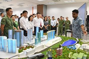 Senior Minister of State for Defence Heng Chee How (front row, second from left) hosted a visit by the Advisory Council on Community Relations in Defence to the Cyber Defence Test and Evaluation Centre in Stagmont Camp.
