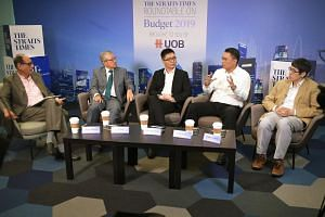 (From left) ST associate editor Vikram Khanna moderating the roundtable with the four panellists: Singapore Business Federation CEO Ho Meng Kit, UOB economist Barnabas Gan, Labour MP and NTUC assistant secretary-general Patrick Tay and Singapore Univ