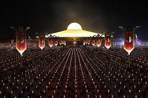 Devotees praying to mark Makha Bucha Day at the Wat Phra Dhammakaya temple near Bangkok on Tuesday.