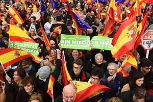 """Demonstrators holding banners that read """"Participants in a coup to prison"""" and """"Go On Spaniards. Scared of nothing and no one"""" at a rallyon Feb 10 to protest against talks between Socialist Prime Minister Pedro Sanchez and Catalan pro-independence le"""