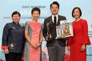ST Athlete of the Year Muhammad Jaris Goh receiving the award from Minister for Culture, Community and Youth Grace Fu, ST sports editor Lee Yulin (left) and managing director of Singapore and YFI Malaysia, F&N Foods Singapore Jennifer See.
