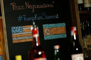 """A bar sells a cocktail named """"Peace Negroniations"""" to commemorate a US-DPRK summit at Tannin Wine Bar in Hanoi, Vietnam on Feb 20, 2019."""