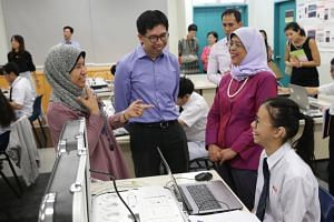 (From left) Hearing loss resource teacher Ms Nafisah Mohd Amin, Beatty Secondary School Principal Ling Khoon Chow, President Halimah Yacob and Secondary Four hearing loss student Khoo Si Tian during a Smart Electrical Technology practical session on