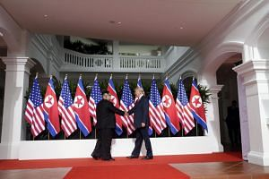 US President Donald Trump and North Korean leader Kim Jong Un at their first summit in Singapore on June 12, 2018. Mr Trump will meet Mr Kim one-on-one in Hanoi over North Korea's nuclear arsenal, according to senior administration officials.