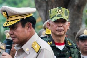 General Apirat Kongsompong (right) pledged that the army will remain neutral in this election, and despite his close ties to Thai Prime Minister Prayut Chan-o-cha (left).