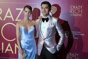 Actor Henry Golding with wife Liv Lo on the red carpet for the Singapore premiere of Crazy Rich Asians held at Capitol Theatre on Aug 21, 2018.