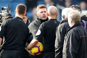 Tottenham manager Mauricio Pochettino remonstrates with referee Mike Dean after the Burnley match.