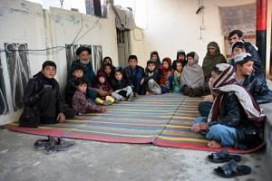Internally displaced Afghans in Kandahar city on Feb 9, 2019, after fleeing conflict with the Taleban in the Deh Rawood district of Uruzgan province.