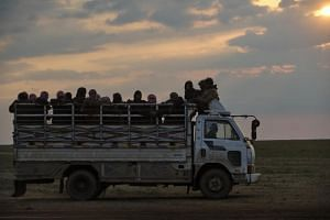 A Syrian Democratic Forces truck at an extraction point for civilians evacuated from the village of Baghouz, the last area held by the Islamic State in Iraq and Syria group.