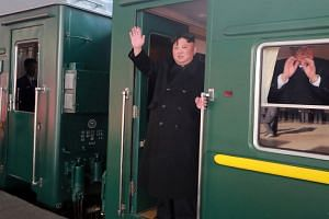 North Korean leader Kim Jong Un took a green train with yellow horizontal stripes that was spotted crossing the Yalu river into China.
