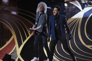 Adam Lambert (right) performs with Brian May of Queen.