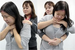 If the person is in a full choke, he will show the universal distress sign of choking by clutching his neck area with his thumb and fingers (left). If the person is not able to cough and you are not trained in the Heimlich manoeuvre (right), do not t