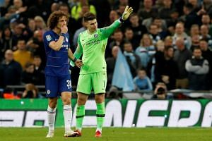 Chelsea's Kepa Arrizabalaga gestures after he is called to be substituted off as David Luiz talks to him at the Wembley Stadium, London, Britain, on Feb 24, 2019.